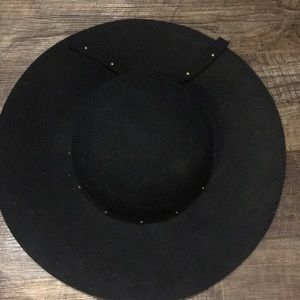 Black wool hat with studded trim